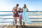 Two moms with daughter at peir, Adoption Evaluations, Coral Gables, FL