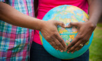 couple holding hands in heart over globe, Adoption Evaluations, Miami, FL