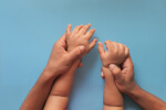 Parent holding childs hands, Adoption Psychological Evalautions, Miami, FL