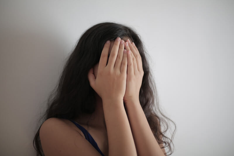 Woman covering her face with her hands, Anxiety Counseling, Miami, FL