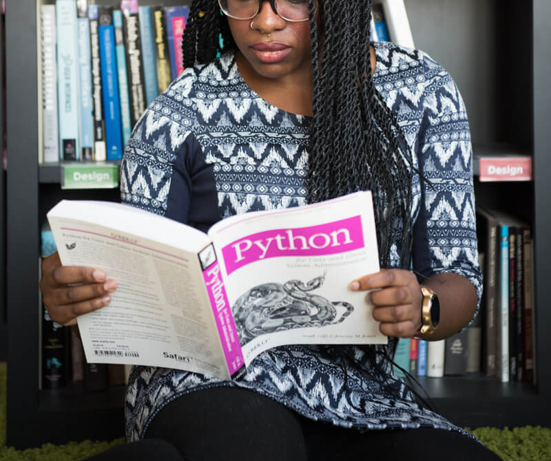 woman reading about coding, Career and Personality Testing, Miami, FL