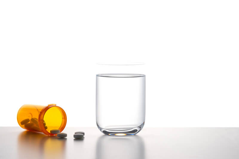 Glass of water with pills, Chronic Medical Conditions, Coral Gables, FL