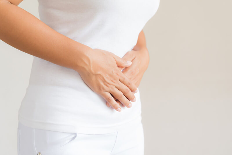 Woman with stomach pain, Chornic Pain Therapy, Coral Gables, FL