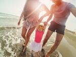 Family having fun on beach, Career Opporotunities, Envision Wellness, Miami