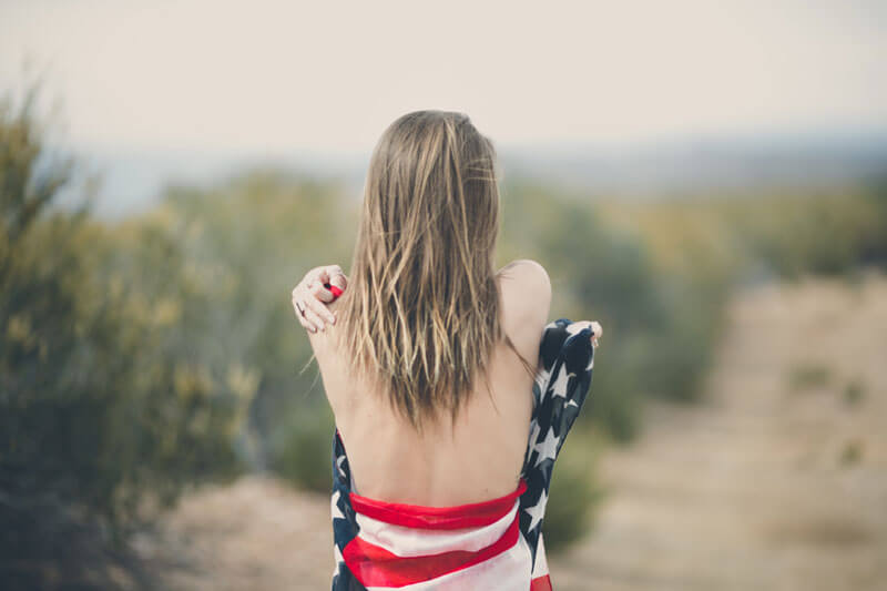 Woman wrapped in american flag, Harship Immigration Evaluations, FL