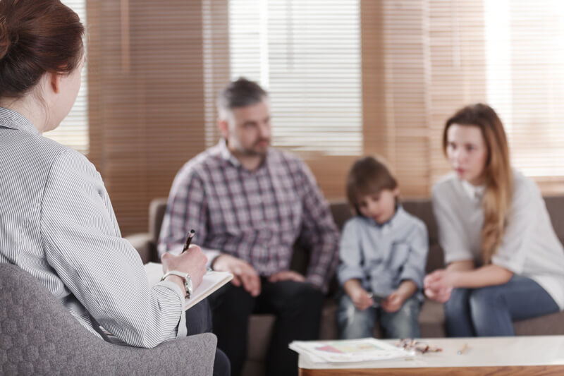 Therapist working with family, Thearpist and Psychologist Jobs in Miami, Envision Wellness