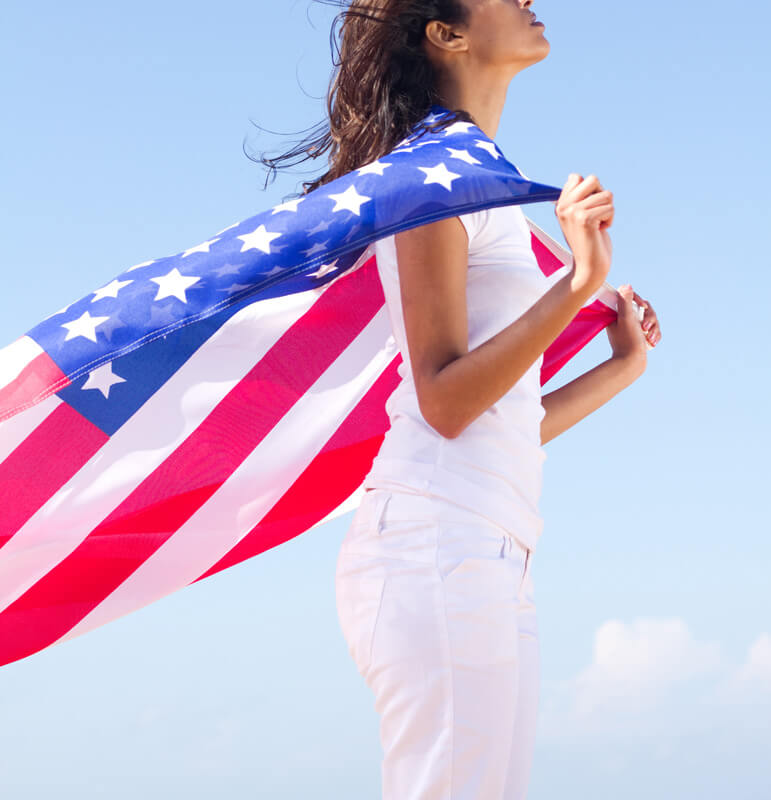 woman with american flag on shoulders, VAWA Immigration Psychological Evaluations, Miami, FL